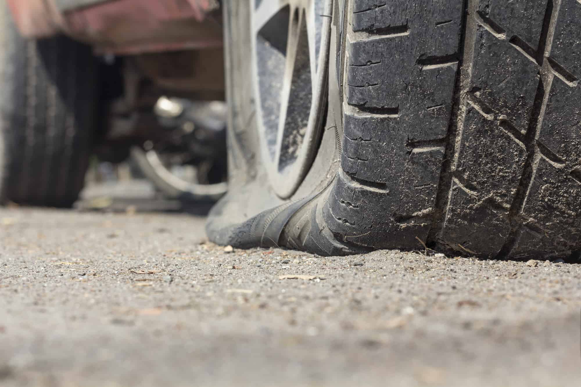 flat tire caused by nail
